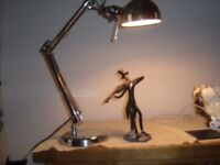 chrome swing arm lamp with deco led glow bulb and in good condition.