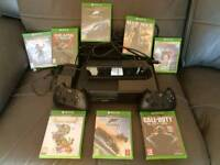 Xbox one, 2 controllers, 8 games, Kinect and battery charger.