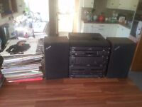 Stereo system with tape, turntable, radio and speakers + 100 vinyl records