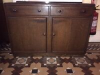 period oak finish sideboard or storage cabinet in very good condition can deliver