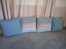 2 Duck blue cushions and 2 Duck blue and beige striped cushions. Used for display only.