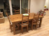 Beautiful solid Ikea dining table and six chairs