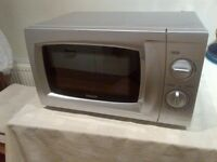 silver microwave oven with dial in excellent condition