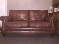 Real leather sofa and arm chairs in brown for sale.