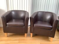 2 brown leather effect tub chairs