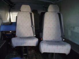 Van seats with built in seat belts