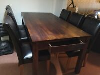 Dining table, solid dark wood, with 6 leather chairs all in Superb Condition
