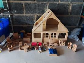 Large wooden dollhouse with accessories