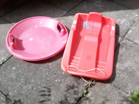 2 Red Plastic Sledges for Fun in the Snow A Bargain at £1.50