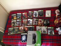 Xbox 360 Elite 250GB boxed condition, controller, charger kit, keypad accessory, and 23 videogames.