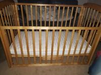 Cot with drop down side