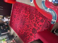 Large red and black rug