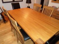 Light Oak Extendable dining table and 4 chairs.