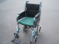 Wheelchair days (Patterson Medical) lightweight folding with a seat belt see description
