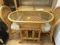 Wicker table and 2. Chairs