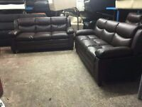Ex display Two 3 seater brown leather sofas