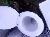 Toilet with tank and flush system for sale. Perfect working order.