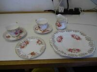 Vintage bone china tea service,22 kt gold markings and handles