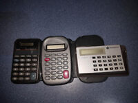 3 Different size Pocket Calculators