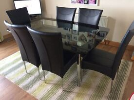Glass Dining Table and 6 Black Chairs