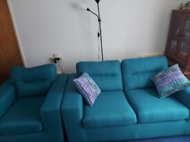 Teal two seater sofa and chair