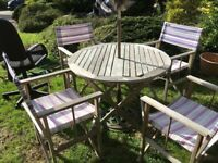 Garden set ......table four chairs and brolly