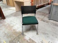 Green fabric and black plastic stackable visitor chairs