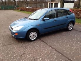 Ford focus 1.8 ghia - Blue , full years MOT - genuine low mileage 74k, full service history