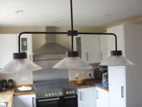 Triple ceiling light fitting for breakfast bar or over dining table.