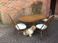 Ercol extending dining table and 4 swan back chairs in excellent condition