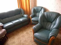 GREEN THREE-PIECE SUITE : THREE-SEATER SOFA AND TWO ARMCHAIRS