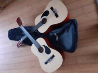 2 childrens learnig guitars and case