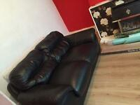 2x2 black leather sofas