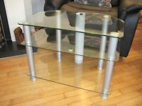 Clear glass media/tv stand with removeable cable tidies.