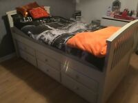 White wooden frame cabin bed