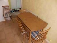 Circular Kitchen Table with 2 folding leaves & 4 chairs