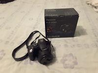 Panasonic Lumix FZ200 Camera-MINT(Box, manual, discs)+Case+2 Hoya Pro Filters+2 spare batteries