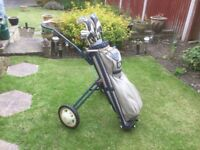 Golf trolley and clubs. Would be ideal for beginner. Old style but still in good working order.