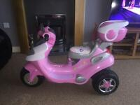 Pink electric kids motor bike