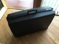 Delsey Suitcase with wheels and handle