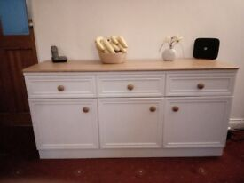 Modern cream sideboard with oak effect top and knobs