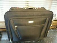 Staples bag on wheels with handle to pull out! Many pockets for laptop documents etc.