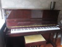 Astor upright piano for sale. Excellent condition. Includes a matching stool.