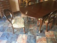 mahogany dining table with 8 ballon backed upholstered chairs good condition