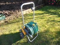 150 feet of Garden hose on a Reel