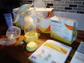 Medela manual breast pump, lanolin cream, pads and more