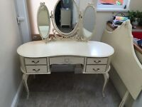 Shabby chic cream mirrored dressing table, wardrobe, chest of drawers and headboard.