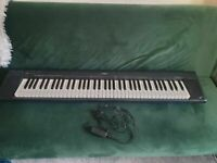 Yamaha NP-30 Portable Grand Digital Piano .with strong stand and power cable fully working