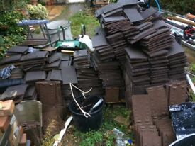Roughly 1100 new 10x6 Roof tiles
