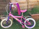 Pink childrens bike